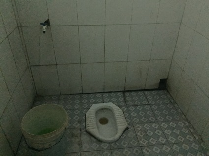 public toilet on road to Hanoi, Vietnam