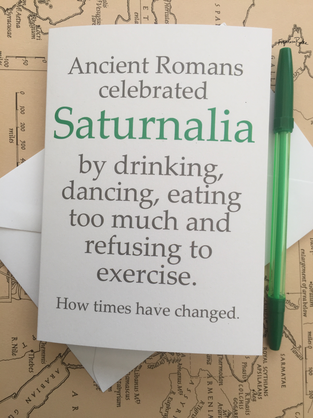 Saturnalia/Roman mythology-inspired Christmas card, green and grey on white card. Portrait design.