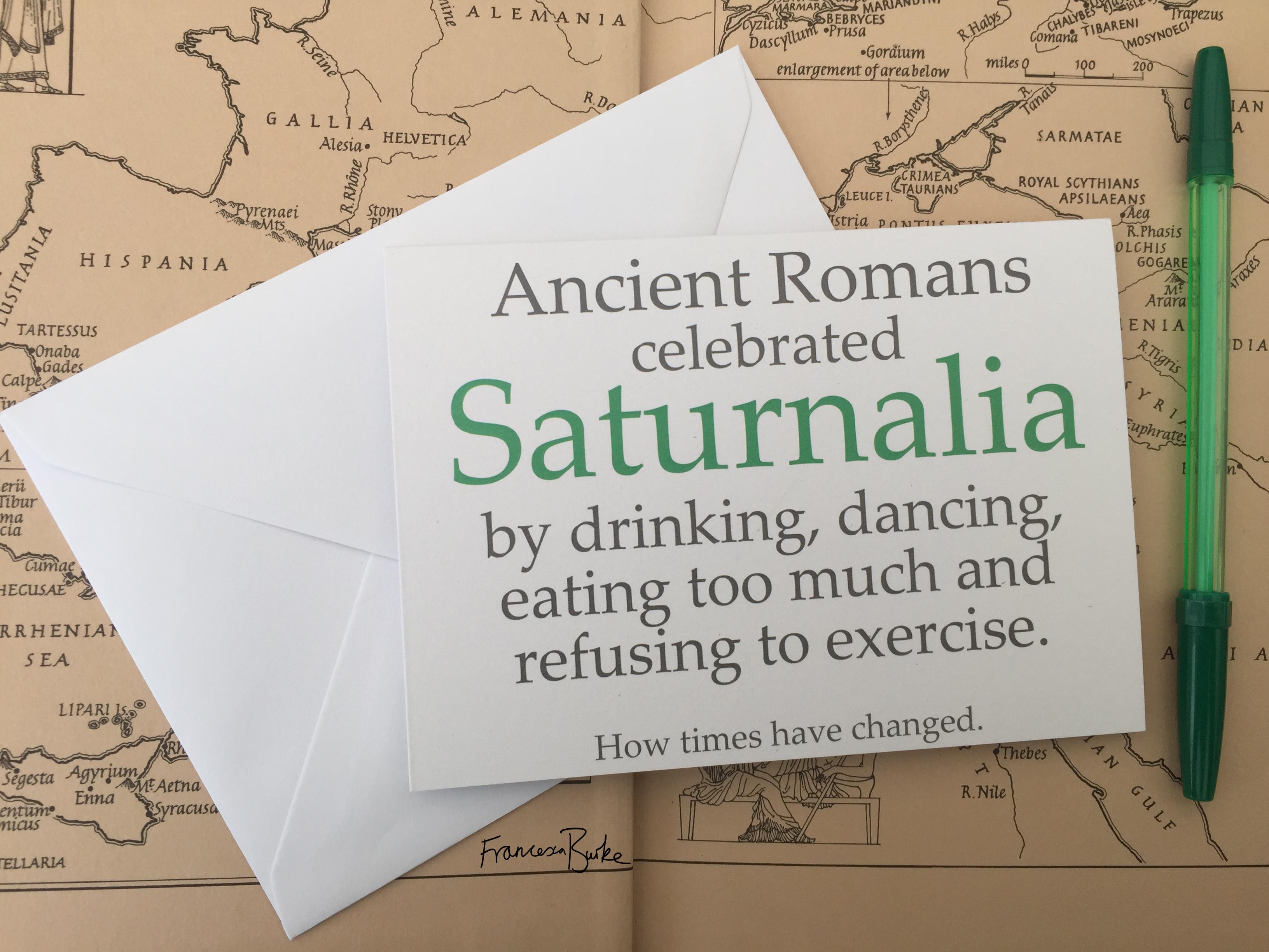 Saturnalia/Roman mythology-inspired Christmas card, green and grey on white card. Landscape.