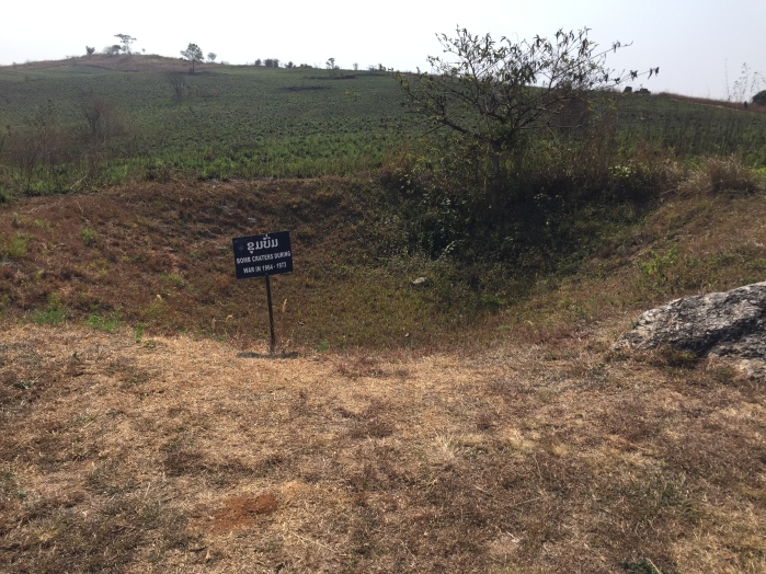 Crater at the Plain of Jars with sign