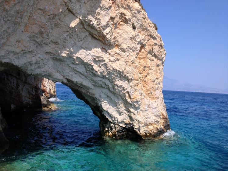 Light rock arch over vivid blue sea at Blue Caves, Zakynthos, Greece
