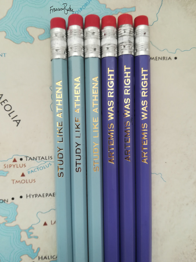 blue pencils reading STUDY LIKE ATHENA, purple pencils reading ARTEMIS WAS RIGHT