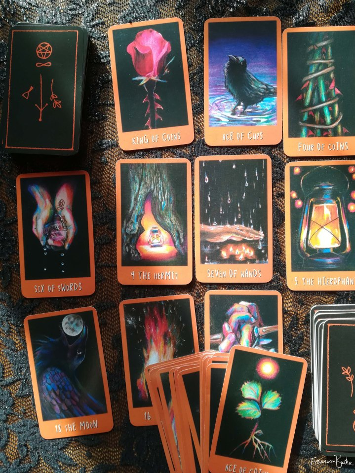 deck of tarot cards on a table