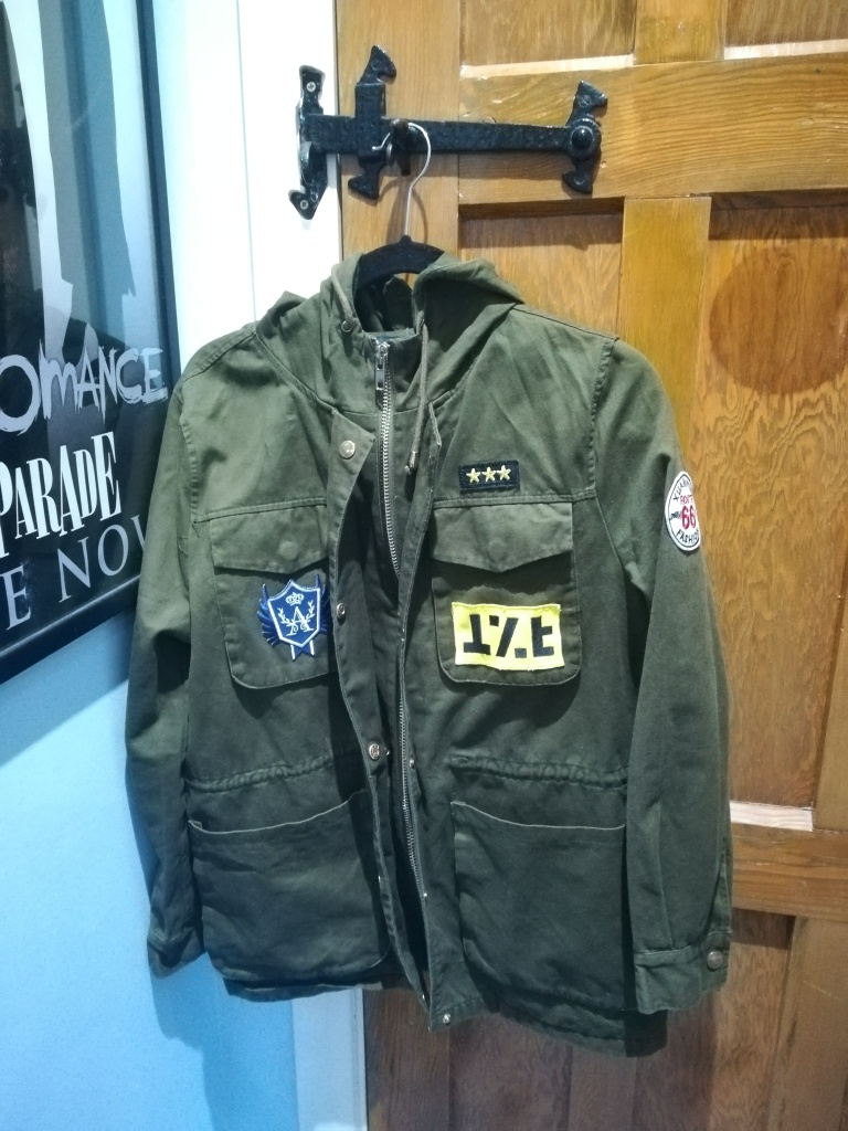 green khaki New Look jacket with MCR and Raven Cycle patches