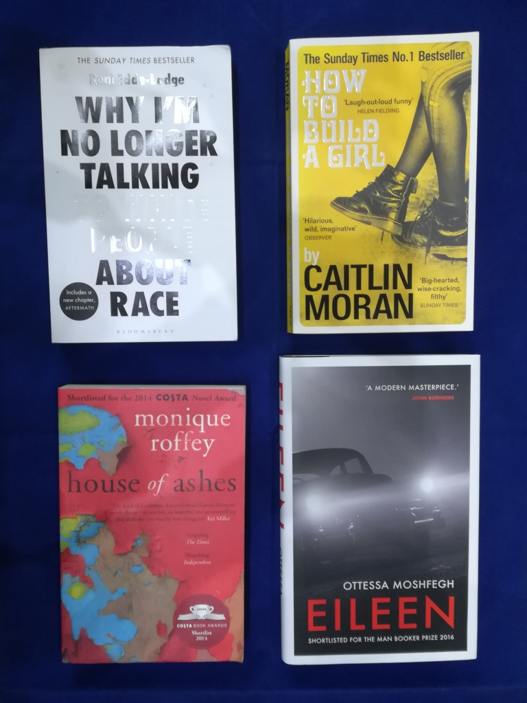 Copies of 'Why I'm No Longer Talking to White People About Race' by Remi Eddo-Lodge, 'How to Build a Girl' by Caitlin Moran, 'House of Ashes' by Monique Roffey and 'Eileen' by Ottessa Moshfegh