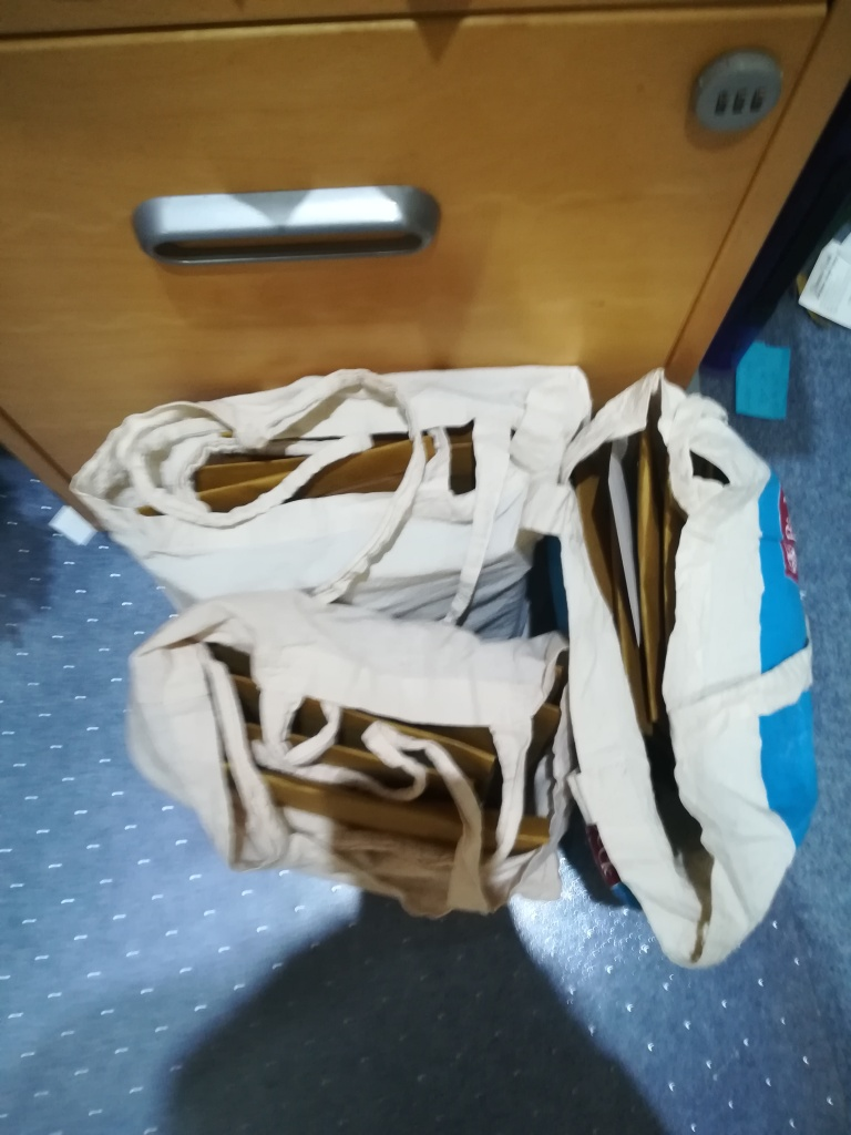 three tote bags full of envelopes