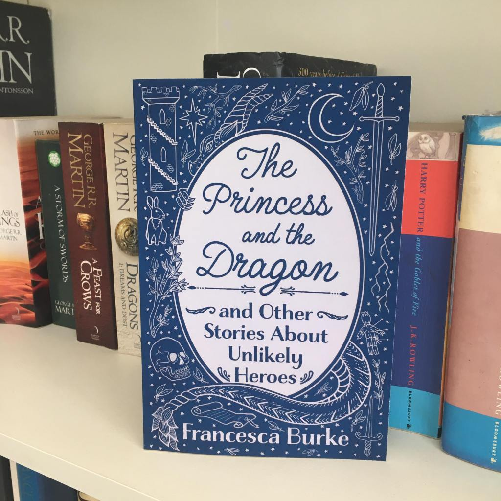 'The Princess and the Dragon and Other Stories About Unlikely Heroes' paperback on shelf