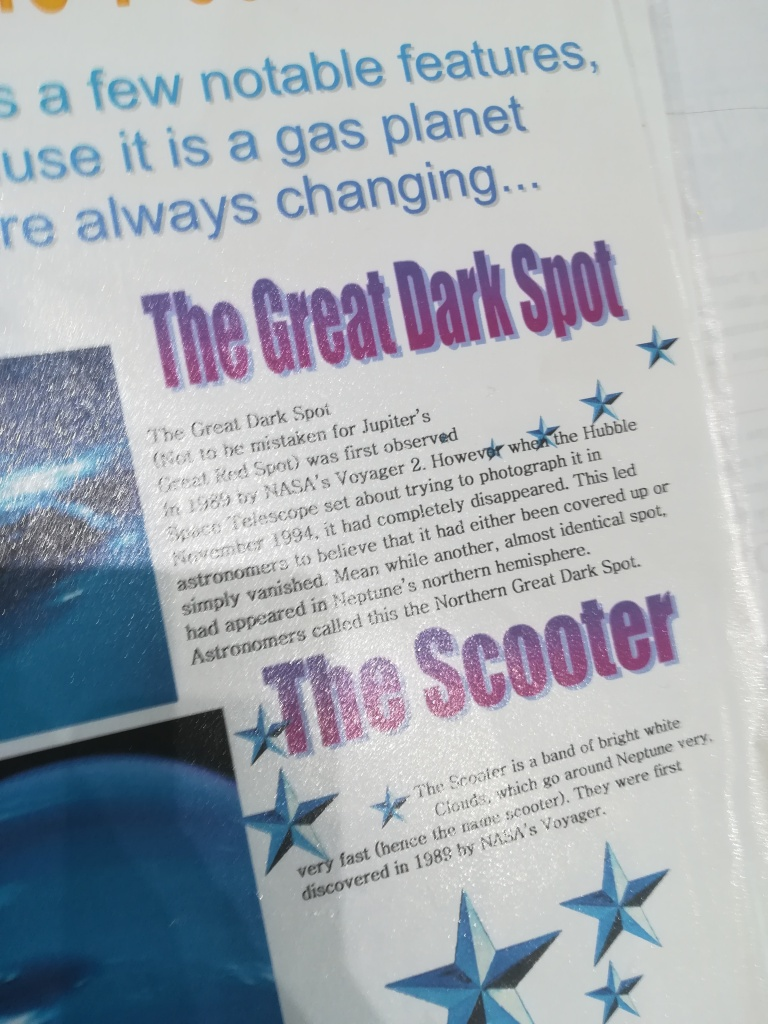 paper with heavily WordArt-covered text about Neptune's Great Dark Spot and The Scooter