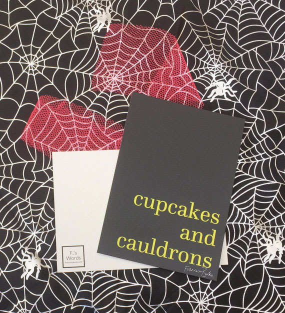 yellow on black print reading 'cupcakes and cauldrons'