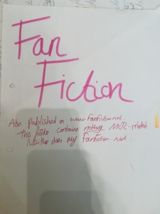 paper reading 'Fan Fiction Also published on www.fanfiction.net. This folder contains nothing MCR-related. Neither does my fanfiction.net.'