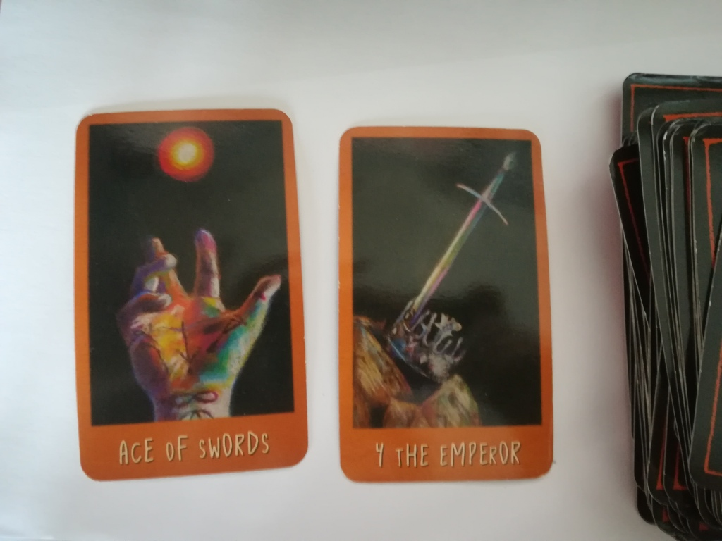 image of the Raven's Prophecy tarot, showing the Ace of Swords and the Emperor